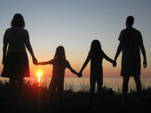 Our Rosey family loving a Lake Michigan sunset